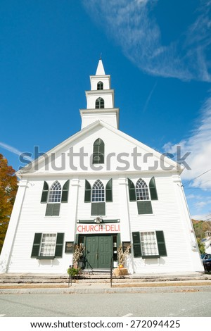 Traditional style 18th century Greek Revival  architectural white wooden church with green window shutters, Newfane, Windham County, Vermont, USA. Original church charter holder was Luke Knowlton, - stock photo