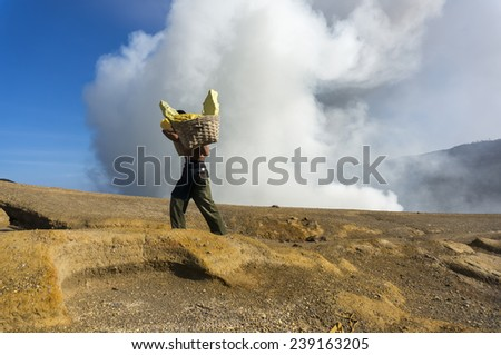 traditional sulphur worker at kawah ijen crater indonesia - stock photo