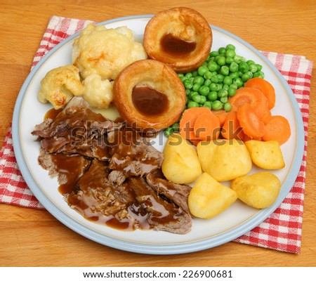 Traditional Sunday roast lamb dinner - stock photo
