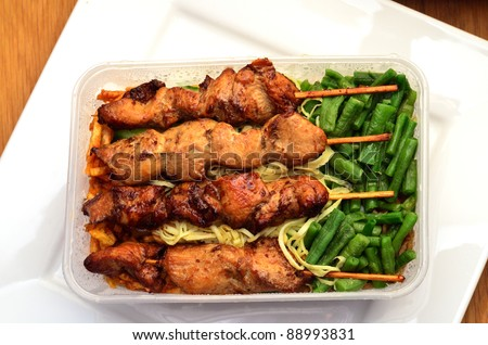 Traditional suriname food in take away box - stock photo