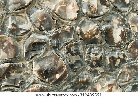 Traditional Sussex wall made of field flints, snapped and laid randomly. - stock photo