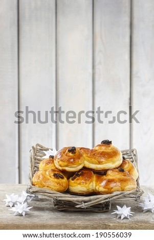 Traditional swedish buns in wicker basket. A saffron bun, in Swedish lussebulle or lussekatt. Copy space - stock photo