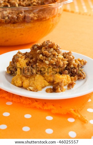 Traditional sweet potato casserole topped with chopped walnuts and plenty of brown sugar. A wonderful side dish for a Thanksgiving or Christmas holiday dinner.