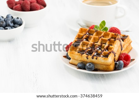 traditional sweet waffles with chocolate and berries, closeup - stock photo