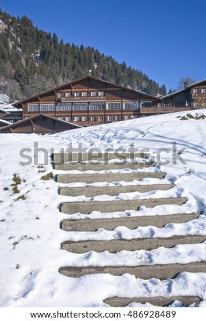Traditional swiss house in winter with snow.