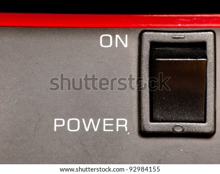 Traditional switch on an electrical device - stock photo