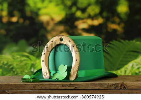 traditional symbols for Patrick's Day - green hat, clover - stock photo