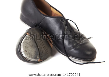 Traditional Tap dancing shoes on a white background and floor - stock photo