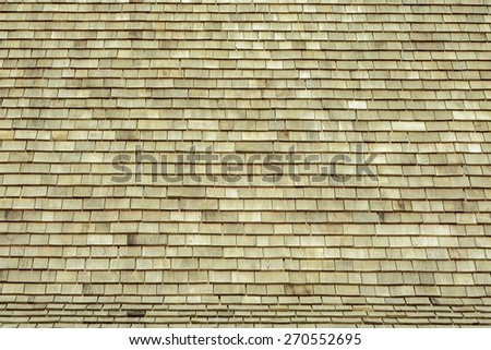 Traditional teak wooden roof tile of old house - stock photo