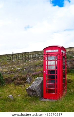 Traditional telephone box in Scotland, in the middle of nowhere - stock photo