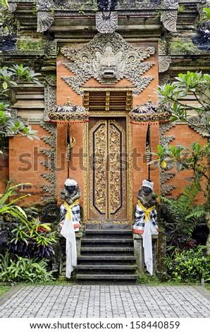 traditional temple door in ubud bali indonesia - stock photo