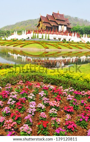Traditional thai architecture in the Lanna style , Royal Pavilion (Ho Kum Luang) at Royal Flora Expo, Chiang Mai, Thailand - stock photo