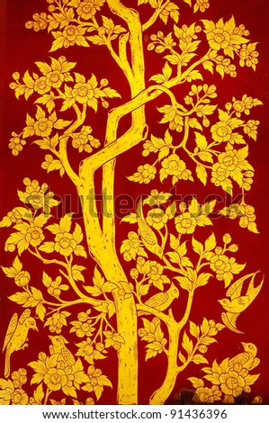 Traditional Thai art of painting on the door of Thai temple. - stock photo