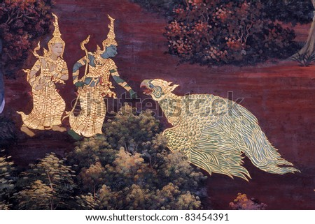 Traditional Thai art painting on a wall, the Emerald Buddha Temp - stock photo