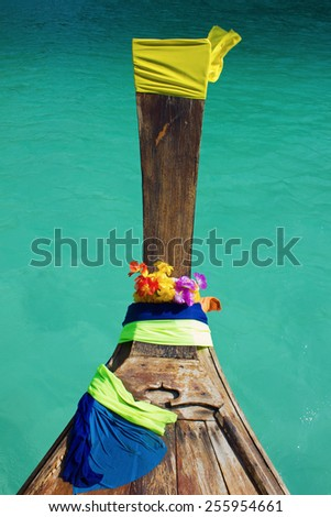 Traditional Thai boat and island of Phi Phi Leh on the horizon,Thailand - stock photo