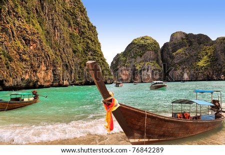 Traditional Thai boat on island Phi-phi, Thailand - stock photo