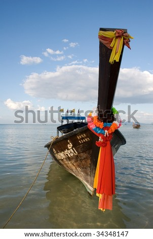 Traditional Thai boat on water - stock photo