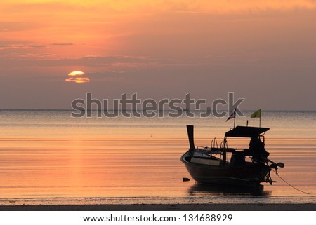 Traditional thai boats at sunset beach.Andaman sea.