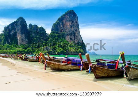 Traditional thai boats at the beach of Krabi province. - stock photo
