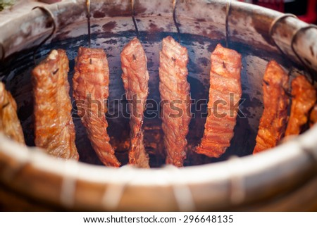 Traditional thai clay oven full of meat. Traditional baked rack of ribs thai cuisine.