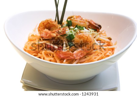 Traditional Thai delicacy made from jumbo shrimps, Thai noodles and prepared with select spices. Garnished with finely chopped green onions. - stock photo