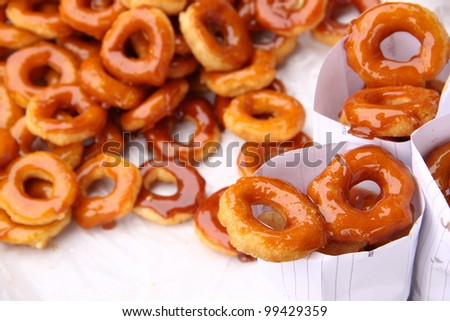 Traditional Thai donut (ka-nom-wong). Mixed of banana or pumpkin with coconut oil, deep fried in round shape. Thai dessert - stock photo