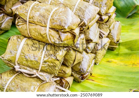 Traditional Thai food style, Glutinous rice steamed with banana wrap banana leaf ( Khao Tom Mat or Khao Tom Pad ) Thai dessert. - stock photo