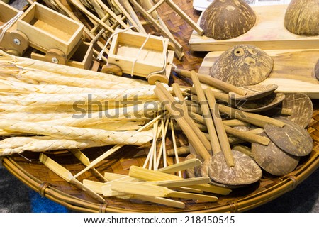 traditional thai handicraft made from coconut shell and bamboo in local thai market - stock photo