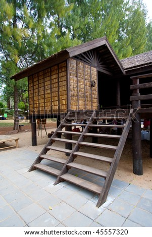 Traditional Thai House in the tropical rainforest. - stock photo