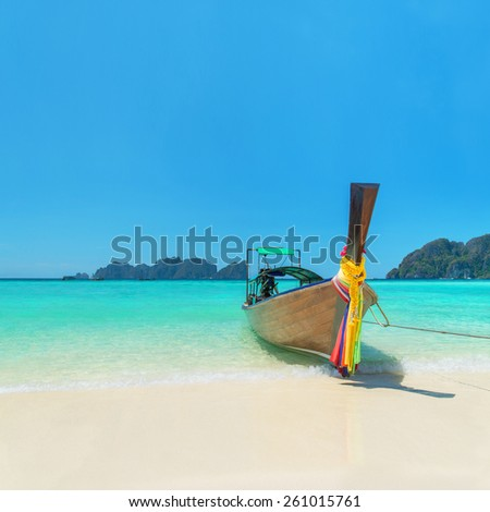 Traditional thai long tail boat at famous sunny Long Beach, Thailand, Koh Phi Phi Don, Krabi province, Andaman sea - stock photo