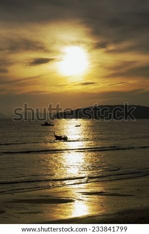 Traditional thai long tail boats at sunset beach, Ao-Nang, Krabi, Thailand - stock photo