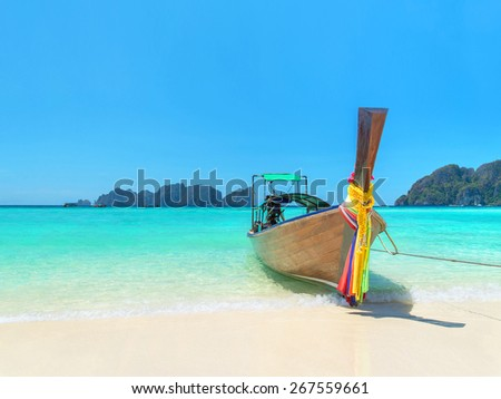 Traditional thai longtail boat at famous sunny Long Beach, Thailand, Koh Phi Phi Don, Krabi province, Andaman sea - stock photo
