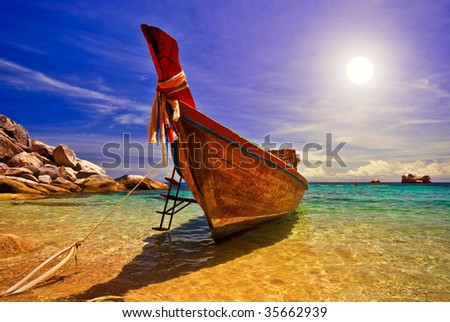 Traditional Thai Longtail Boat at Sunset
