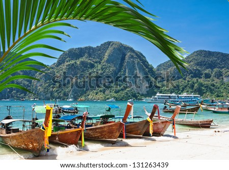 Traditional Thai Longtail boat on the beach of Phi Phi Don,Thailand - stock photo