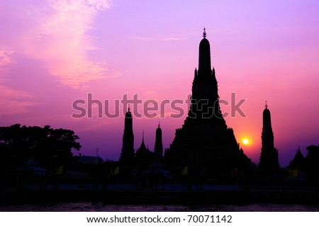 Traditional Thai style architecture silhouette with sunset - stock photo