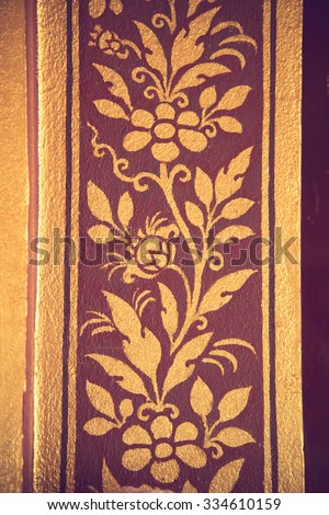 traditional Thai style art gold painting pattern on the door vintage color - stock photo