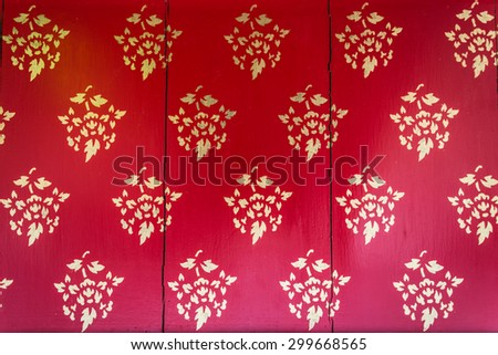 Traditional Thai style church door art - stock photo