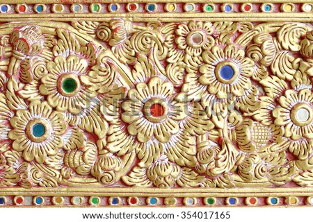 Traditional Thai style flower pattern decorative,  old stucco gold paint in temple,Thailand. - stock photo