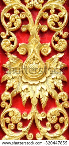 Traditional Thai style flower pattern decorative, stucco gold paint in temple,Thailand. - stock photo