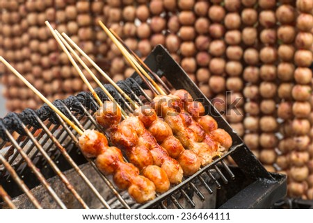 Traditional Thai style grilled meat roll. Asian street food. - stock photo