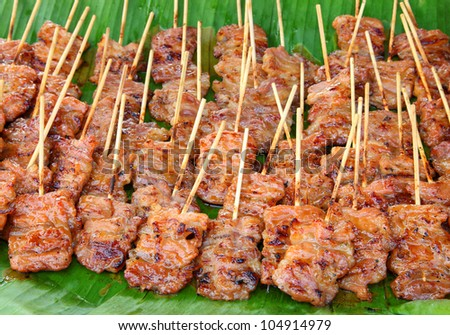 Traditional Thai style grilled pork  on the banana leaf - stock photo