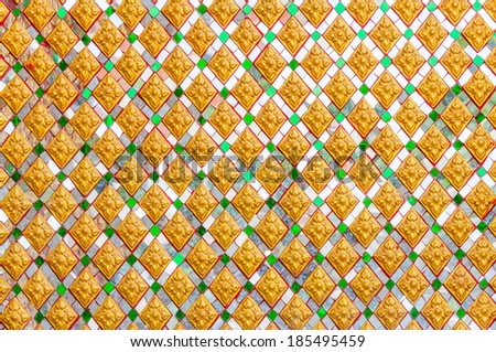 Traditional Thai style of Buddhist church wall pattern - stock photo