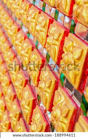 Traditional Thai style of Buddhist church wall pattern - stock photo