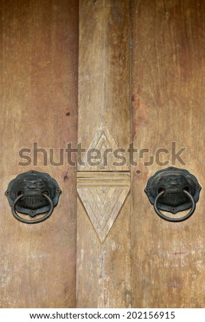 Traditional Thai style old wooden door - stock photo