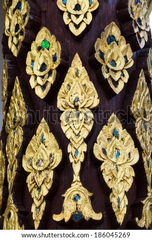 Traditional Thai style on temple door in Thailand - stock photo