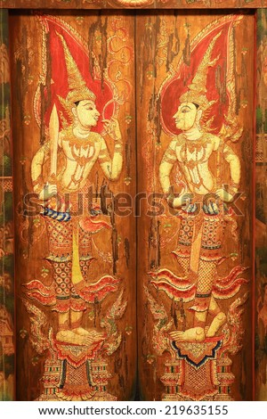 Traditional Thai style painting art on temple wall - stock photo