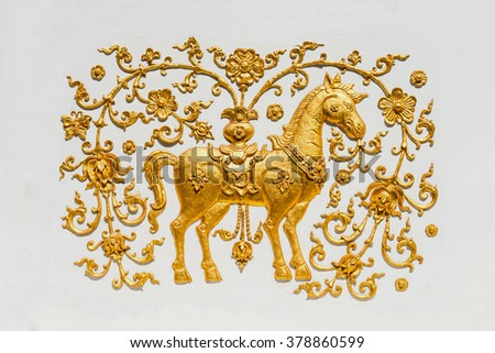 Traditional Thai style pattern decorative stucco gold paint in Buddhist temple Chiang Rai,Thailand ( A mythical horse) - stock photo