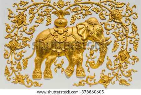 Traditional Thai style pattern decorative stucco gold paint in Buddhist temple Chiang Rai,Thailand ( A mythical elephant) - stock photo