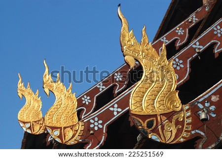 Traditional Thai style wood craft decoration roof of temple in Northern of Thailand - stock photo