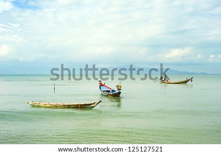 Traditional thailand boats  in the sea at sunrise